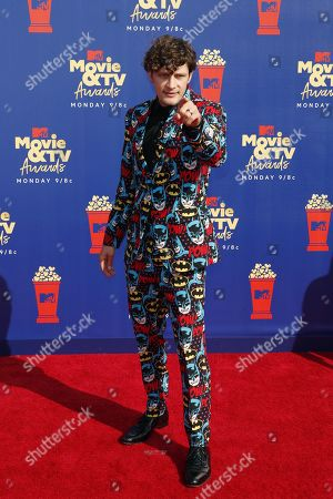 Brett Dier arrives for the 2019 MTV Movie & TV Awards at the Barker Hangar, Santa Monica, California, USA, 15 June 2019. The movies are nominated by producers and executives from MTV and the winners are chosen online by the general public.