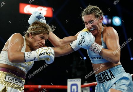 Mikaela Mayer, right, and Lizbeth Crespo exchange blows during a boxing bout, in Las Vegas