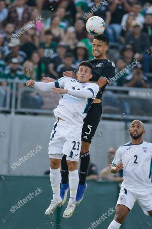 Cuba midfielder Luis Paradela (23) and Mexico defender Diego Reyes (5) fight for a head ball during a CONCACAF Gold Cup soccer match between Mexico and Cuba in Pasadena, Calif., . Mexico won 7-0