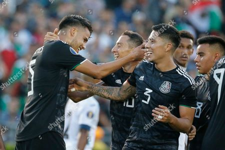 Mexico defender Diego Reyes (5) celebrates his goal with teammates during a CONCACAF Gold Cup soccer match between Mexico and Cuba in Pasadena, Calif., . Mexico won 7-0