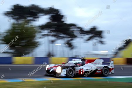 Stock Image of The Toyota TS050 Hybrid No7 of the Toyota Gazoo Racing Team driven by Mike Conway of Britain, Kamui Kobayashi of Japan and Jose Maria Lopez of Argentina races early morning during the 87th 24-hour Le Mans endurance race, in Le Mans, western France