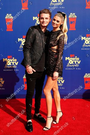 James Kennedy and Raquel Leviss arrive for the 2019 MTV Movie & TV Awards at the Barker Hangar, Santa Monica, California, USA, 15 June 2019. The movies are nominated by producers and executives from MTV and the winners are chosen online by the general public.
