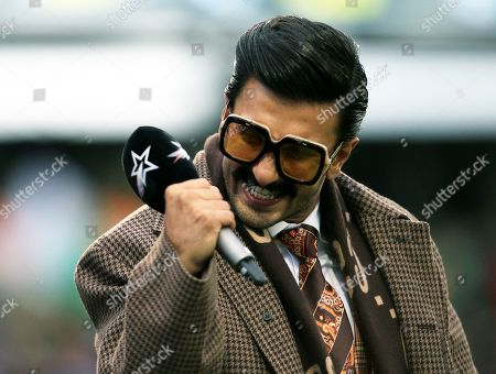 Bollywood star and India fan Ranveer Singh celebrates at the end of the game