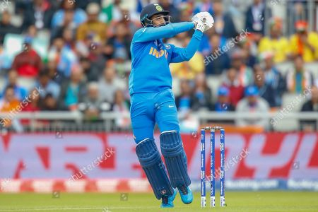 K. L. Rahul of India hits the ball for four, bowled Mohammad Amir of Pakistan (not in picture) during the ICC Cricket World Cup 2019 match between India and Pakistan at Old Trafford, Manchester