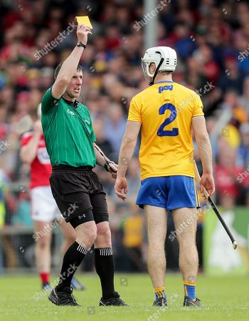 Clare vs Cork. Clare's Patrick O'Connor receives a yellow card from referee Paul O'Dwyer