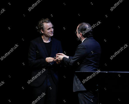 Stock Photo of Alexander Schallenberg (R), Austrian Minister for Europe and Integration, and Minister within the Federal Chancellery for the EU, Arts, Culture, and Media, hands over the Iffland Ring to German actor Jens Harzer (L) during the Iffland-Ring awarding at the Burgtheater in Vienna, Austria, 16 June 2019. Jens Harzer receives the Iffland Ring, which is awarded to the most worthy actor of the German-speaking theatre.