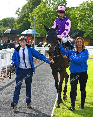 Winner of The Cara Glass Fillies' Handicap Daddy's  Daughter ridden by Robert Winston and trained by Dean Ivory is led into the Winners enclosure during Horse Racing at Salisbury Racecourse on 16th June 2019