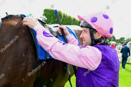 Jockey Robert Winston unsaddles Daddy's Daughter in the Winners enclosure after winning The Cara Glass Fillies' Handicap during Horse Racing at Salisbury Racecourse on 16th June 2019