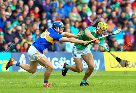 Tipperary vs Limerick. Tipperary's Jason Forde tackles Limerick's Dan Morrissey