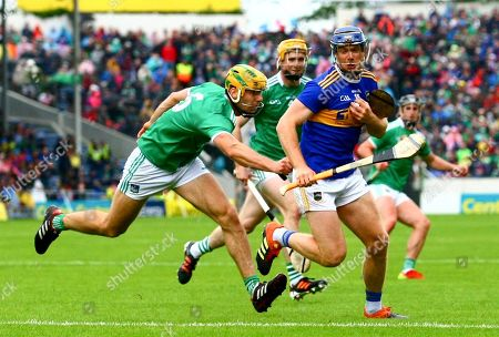 Tipperary vs Limerick. Tipperary's John McGrath with Limerick's Dan Morrissey