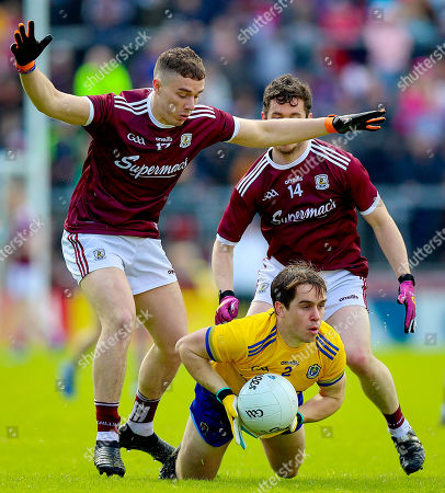 Galway vs Roscommon. Galway's Eamonn Brannigan and Ian Burke with David Murray of Roscommon