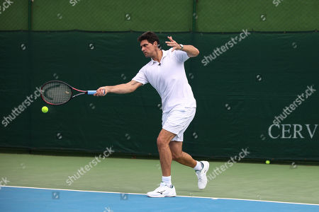 Stock Photo of Mark Philippoussis hosts a tennis workshop