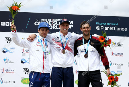 Joseph Clarke of Great Britain celebrates winning the mens MK1 Final with silver medalist Jiri Prskavec of Czech Republic and bronze medalist Hannes Aigner of Germany.
