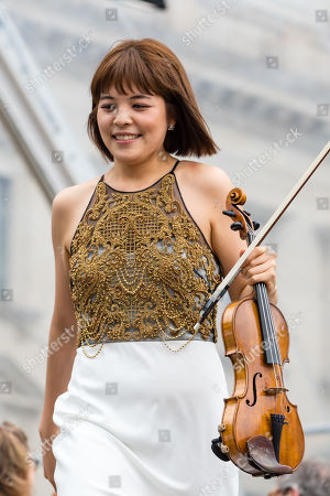 The first concertmaster Jiyoon Lee stands during a concert under the slogan 'Opera for All' on an open air stage in Berlin, Germany, 16 June 2019. For more than a decade the Staatskapelle Berlin and Argentinian-Israeli conductor Daniel Barenboim have been playing an open-air concert for residents of Berlin and their guests.