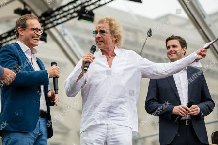 """Berlin Governing Mayor Michael Mueller (L-R), German TV presenter Thomas Gottschalk and Director of the Berlin State Opera Matthias Schulz stand before the beginning a concert under the slogan """"Opera for All"""" on an open air stage in Berlin, Germany, 16 June 2019. For more than a decade the Staatskapelle Berlin and Argentinian-Israeli conductor Daniel Barenboim have been playing an open-air concert for residents of Berlin and their guests."""