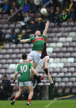 Galway vs Mayo. Mayo's Sean Walsh with Conor Brady of Galway