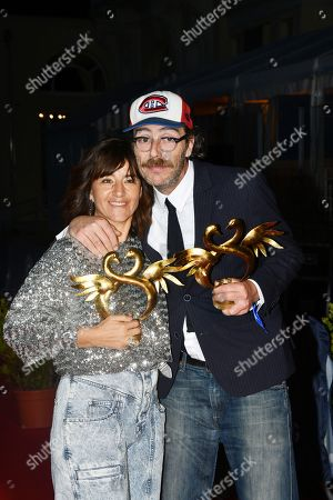 Romane Bohringer and Philippe Rebbot pose with their awards for Best First Film