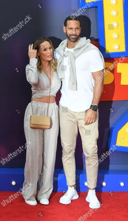 Former Manchester United defender, Rio Ferdinand (R) arrives with partner Kate Wright to the red carpet for the European premiere of 'Toy Story 4' in London, Britain, 16 June 2019. The computer-animated comedy is produced by Pixar Animation Studios for Walt Disney Pictures.