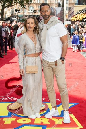 Rio Ferdinand, Kate Wright. Rio Ferdinand and Kate Wright pose for photographers upon arrival at the screening for 'Toy Story 4' in London