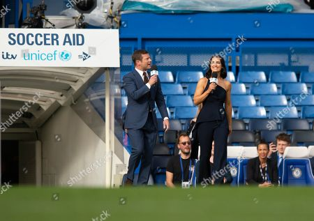 Hosts Dermot O'Leary and Kirsty Gallacher enter the pitch before the Soccer Aid for Unicef match