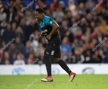Stock Image of DJ Locksmith of Soccer Aid World XI celebrates after scoring his penalty during the shoot out