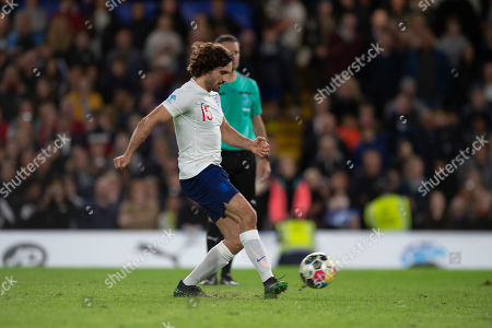Joe Wicks of England takes his penalty during the shoot out