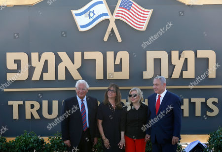 US Ambassador to Israel David Friedman (L) and his wife Tammy (2-L) and the Israeli Prime Minister Benjamin Netanyahu (R) and his wife Sara (2-R) during the unveiling of the sign of the new settlement that approved by the Israeli cabinet earlier today and will be called 'Trump Heights', during an official ceremony in Bruchim-Kela Alon Golan Heights, 16 June 2019. After a festive cabinet that held in Bruchim-Kela Alon, Netanyahu cabinet approved the building of a new settlement in the Golan Heights which is to be named after US President Trump over his unilateral recognition of Israeli sovereignty over the Golan Heights. Israel takeover the Golan Heights during the six days war between Israel and Syria in 1967, and annexed to Israel in 1981.