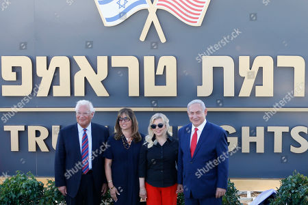 Israeli Prime Minister Benjamin Netanyahu, right, his wife Sara, United States Ambassador to Israel David Friedman, left, his wife Tammy pose during the inauguration of a new settlement named after President Donald Trump in the Golan Heights, . The Trump name graces apartment towers, hotels and golf courses. Now it is the namesake of a tiny Jewish settlement in the Israeli-controlled Golan Heights