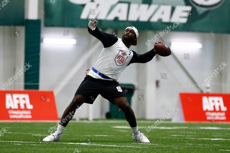Florida Fury's Michael Vick throws the ball against Fighting Cancer during the American Flag Football League Tournament in Florham Park, N.J