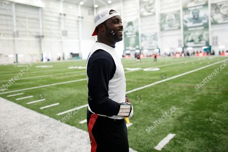 Florida Fury's Michael Vick stands on the sidelines during a game against Fighting Cancer during the American Flag Football League Tournament in Florham Park, N.J