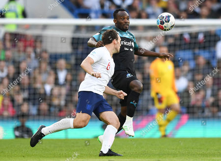 Michael Essien of the World XI under pressure from Sam Claflin of England XI