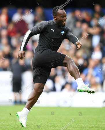 Michael Essien of the World XI warming up