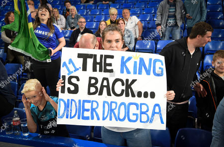 A young fan holds up a Didier Drogba sign