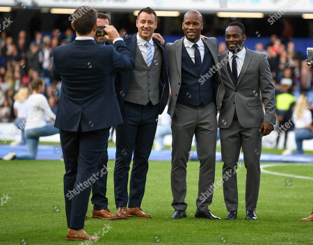 John Terry of England XI Didier Drogba of the World XI and Michael Essien of the World XI pose for a photo