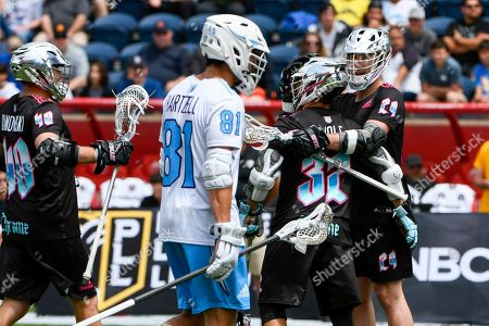 Chrome's Matt Danowski (40), Jordan Wolf (32), and Jordan MacIntosh (29) celebrate a goal as Atlas' Kyle Hartzell looks on during a Premier Lacrosse League game on in Bridgeview, Ill