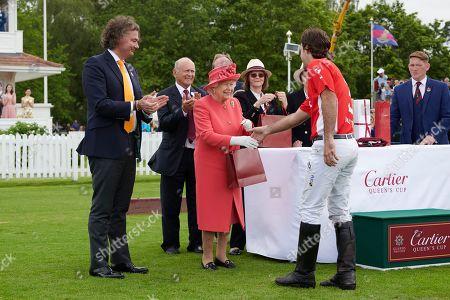Laurent Feniou and Queen Elizabeth II