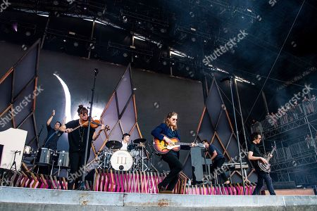 Lauren Jacobson, Jeremiah Fraites, Wesley Schultz, Byron Isaacs. Lauren Jacobson, from left, Jeremiah Fraites, Wesley Schultz, and Byron Isaacs of The Lumineers performs at the Bonnaroo Music and Arts Festival, in Manchester, Tenn