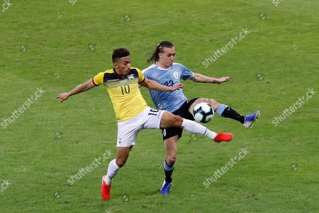Uruguayan Diego Laxalt (R) vies for the ball with Ecuadorian Angel Mena (L) during the Copa America 2019 Group C soccer match between Uruguay and Ecuador, at Mineirao Stadium in Bello Horizonte, Brazil, 16 June 2019.