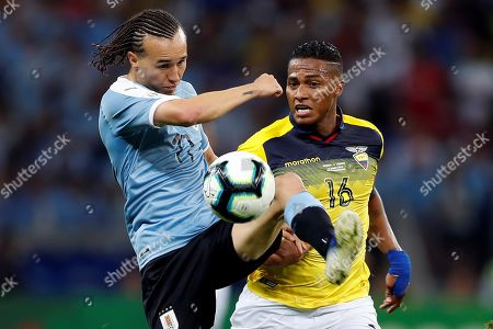 Uruguayan Diego Laxalt (L) vies for the ball with Ecuadorian Antonio Valencia (R) during the Copa America 2019 Group C soccer match between Uruguay and Ecuador, at Mineirao Stadium in Bello Horizonte, Brazil, 16 June 2019.