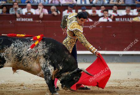 "Alberto Lopez Simon performs during the ""Press Bullfighting"", part of the Saint Isidore fair, at the Las Ventas bullring, in Madrid, Spain, 16 June 2019."