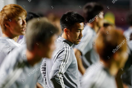 Japan's Shinji Okazaki attends a training session with his national soccer team in Sao Paulo, Brazil, . Japan will face Chile on Monday for a Group C match during the Copa America soccer tournament