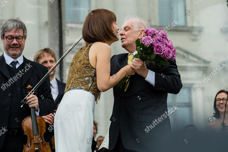 Argentinian-Israeli conductor Daniel Barenboim (R) and the first concertmaster Jiyoon Lee (L) stand during a concert under the slogan 'Opera for All' on an open air stage in Berlin, Germany, 16 June 2019. For more than a decade the Staatskapelle Berlin and Daniel Barenboim have been playing an open-air concert for residents of Berlin and their guests.