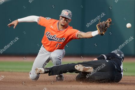 Mississippi State's Jordan Westburg (11) steals second base against Auburn shortstop Will Holland (17) in the first inning of an NCAA College World Series baseball game in Omaha, Neb