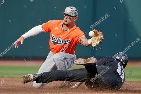 Jordan Westburg, Will Holland. Mississippi State's Jordan Westburg (11) steals second base against Auburn shortstop Will Holland (17) in the first inning of an NCAA College World Series baseball game in Omaha, Neb