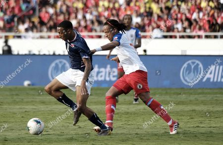 Herold Charles (R) of Haiti in action against Willie Clemons (L) of Bermuda during the CONCACAF Gold Cup soccer match between Bermuda and Haiti in San Jose, Costa Rica, 16 June 2019.
