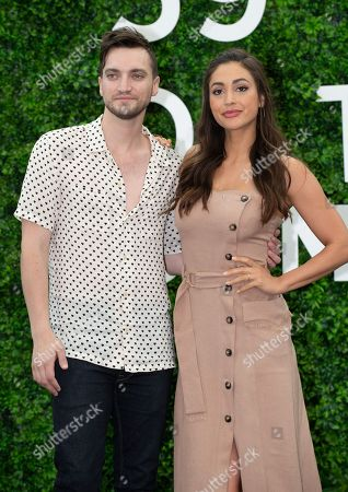 Stock Picture of Richard Harmon and Lindsey Morgan