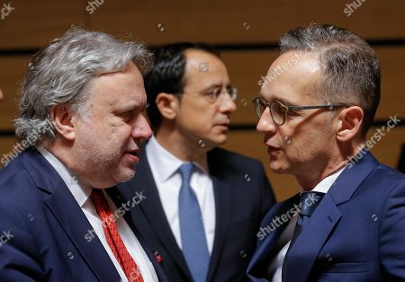 Stock Picture of Greek Foreign Affairs Minister Georgios Katrougalos (L) talks with German Minister of Foreign Affairs Heiko Maas (R) at the start of the Foreign Affairs Ministers Council meeting in Luxembourg, 17 June 2019. The Foreign Affairs Council will start with a discussion on current affairs to review pressing issues on the international agenda. Ministers, joined by defense ministers, will have a comprehensive discussion on the EU Global Strategy.