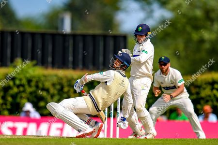 Steven Finn of Middlesex avoids a bouncer from Markus Labuschagne of Glamorgan during the Specsavers County Champ Div 2 match between Middlesex County Cricket Club and Glamorgan County Cricket Club at Radlett Cricket Ground, Radlett, Herfordshire