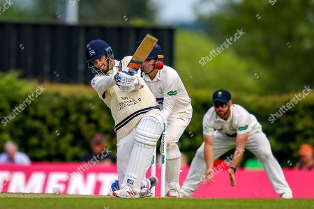 Steven Finn of Middlesex hits four runs during the Specsavers County Champ Div 2 match between Middlesex County Cricket Club and Glamorgan County Cricket Club at Radlett Cricket Ground, Radlett, Herfordshire