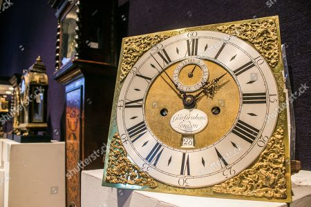 Stock Picture of A good early 18th century numbered 8-day walnut longcase clock George Graham, London. Estimate 40,000- 60,000.